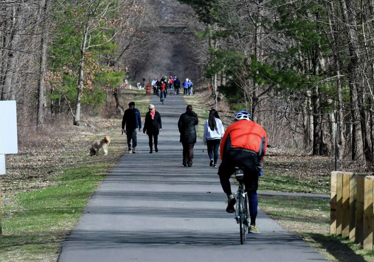 The Albany County Helderberg-Hudson Rail Trail remains as popular as ever, as exercise seekers ride and walk along the nine mile path on Wednesday afternoon, April 1, 2020, in Bethlehem, N.Y. (Will Waldron/Times Union)