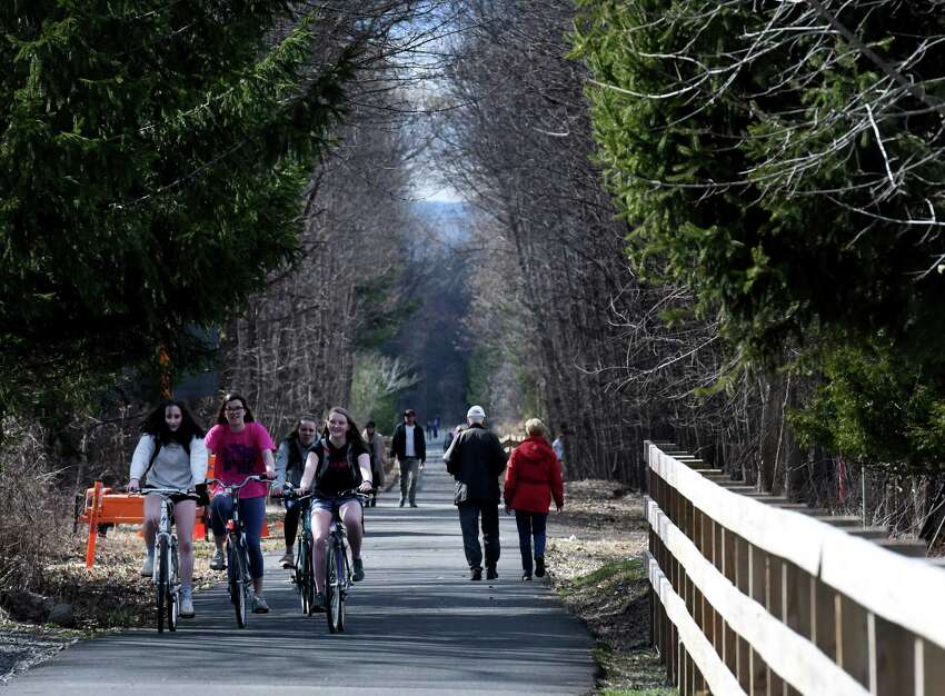 Times Union meteorologist Jason Gough says a weekend warm-up is on the way. In this photograph walkers and bikers weren't waiting for the heat. The Albany County Helderberg-Hudson Rail Trail remains as popular as ever, as exercise seekers ride and walk along the nine mile path on Wednesday afternoon, April 1, 2020, in Bethlehem, N.Y. (Will Waldron/Times Union)