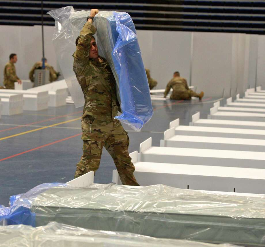 The national guard arrived Wednesday at the O'Neill Center on Western Connecticut State University Westside campus to begin to transform the building into a 219 bed medical space that would be used if area hospitals see a surge in patients. Wednesday, April 1, 2020, in Danbury, Conn. Photo: H John Voorhees III / Hearst Connecticut Media / The News-Times