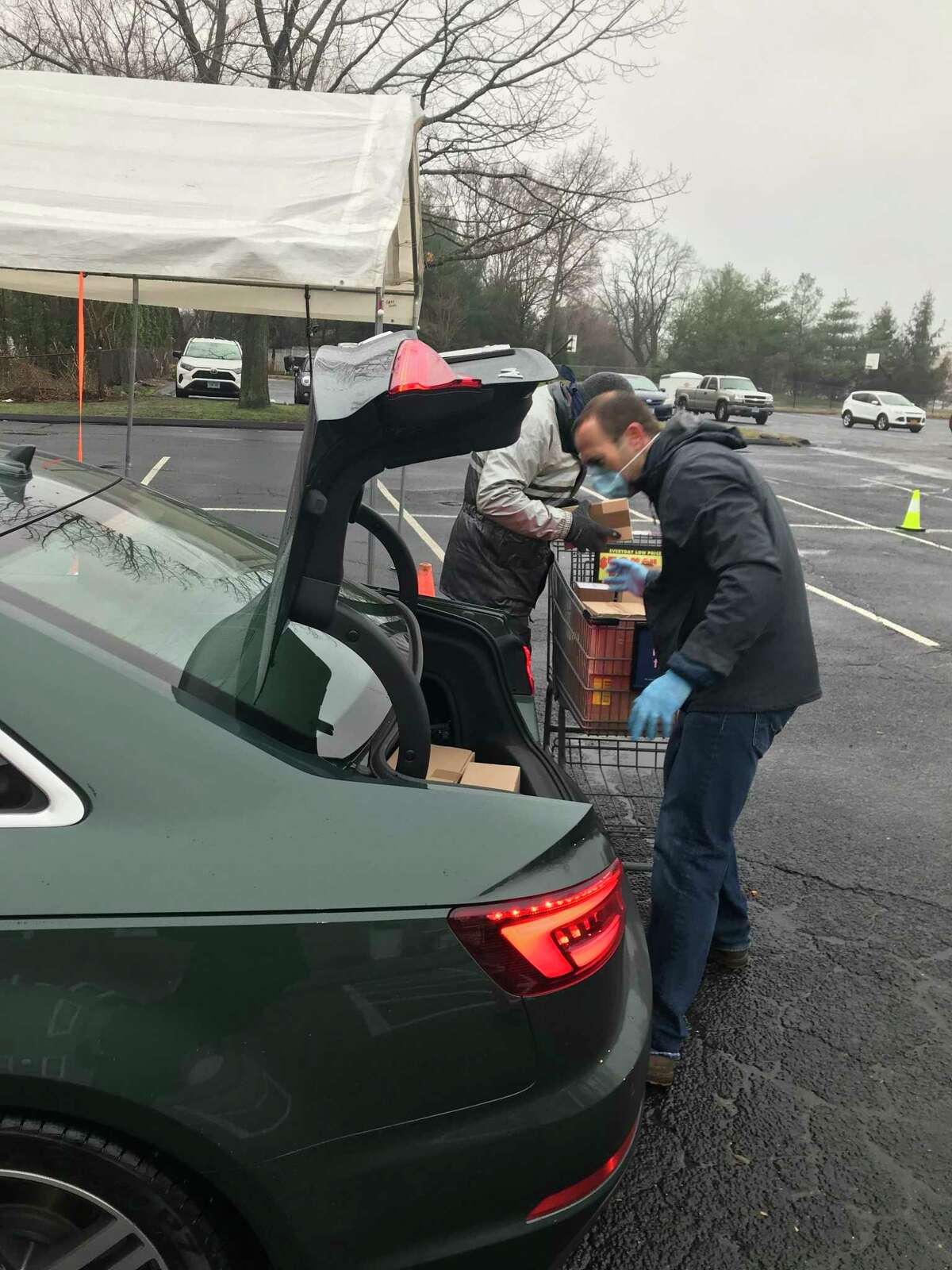 Volunteers unloading groceries during the food drive on March 29.