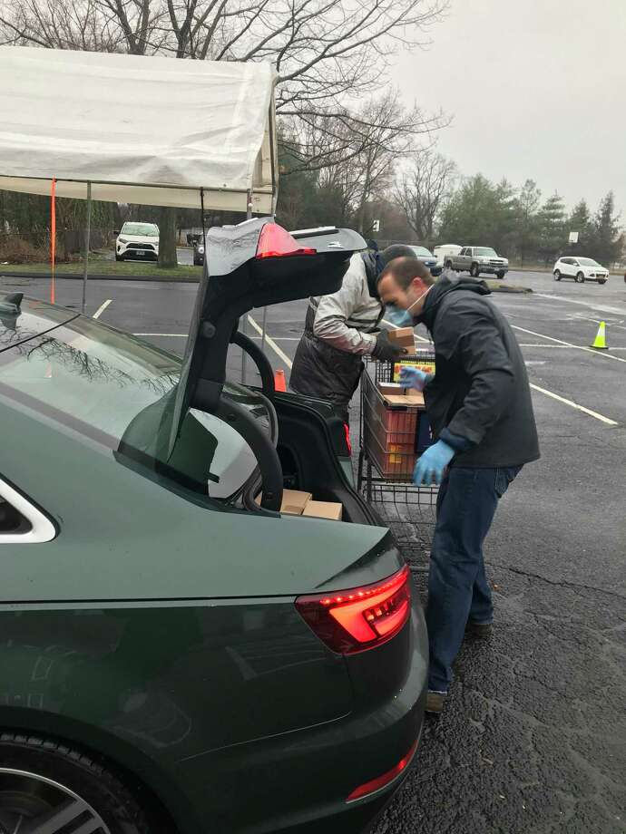 Volunteers unloading groceries during the food drive on March 29. Photo: / Alexis Harrison