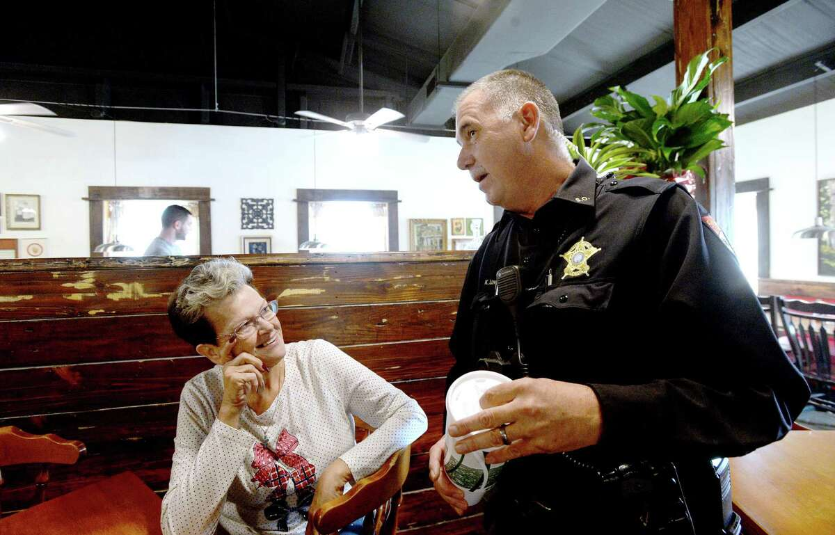 Martha Vautrot greets and jokes with customers, including Jefferson County Sheriff Deputy Lovett, as they arrive for lunch at Vautrot's Cajun restaurant on its grand reopening Tuesday. The popular Bevil Oaks eatery was destroyed during Tropical Storm Harvey and operated out of a food truck while building a new restaurant. Photo taken Tuesday, Jan. 28, 2020 Kim Brent/The Enterprise