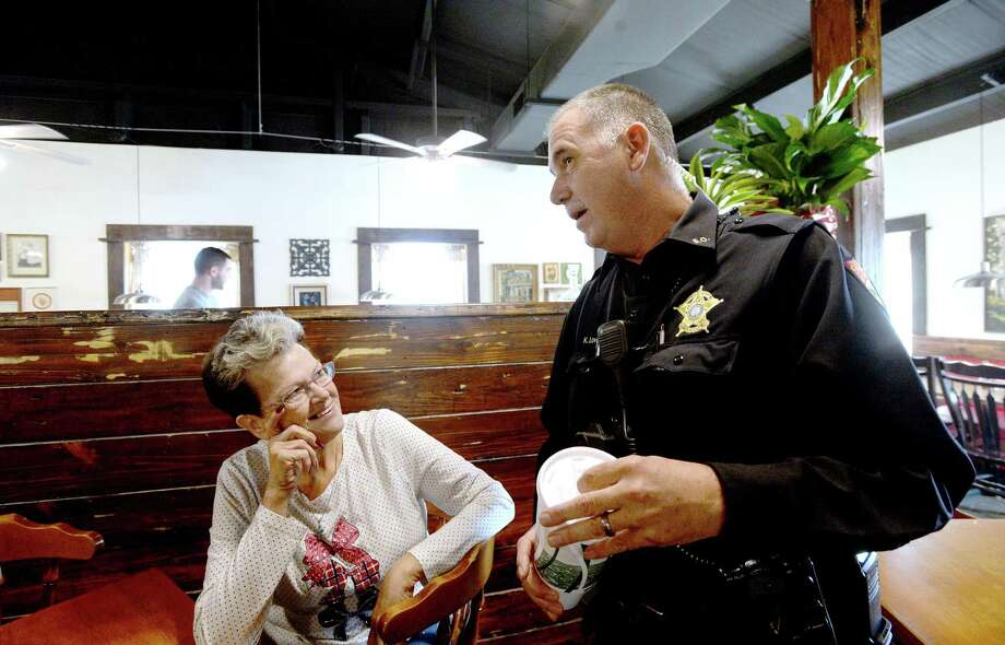 Martha Vautrot greets and jokes with customers, including Jefferson County Sheriff Deputy Lovett, as they arrive for lunch at Vautrot's Cajun restaurant on its grand reopening Tuesday. The popular Bevil Oaks eatery was destroyed during Tropical Storm Harvey and operated out of a food truck while building a new restaurant. Photo taken Tuesday, Jan. 28, 2020 Kim Brent/The Enterprise Photo: Kim Brent / The Enterprise / BEN