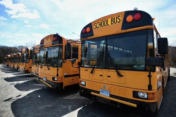 School buses are parked in neat rows at the Trumbull school bus depot in Trumbull on April 1.