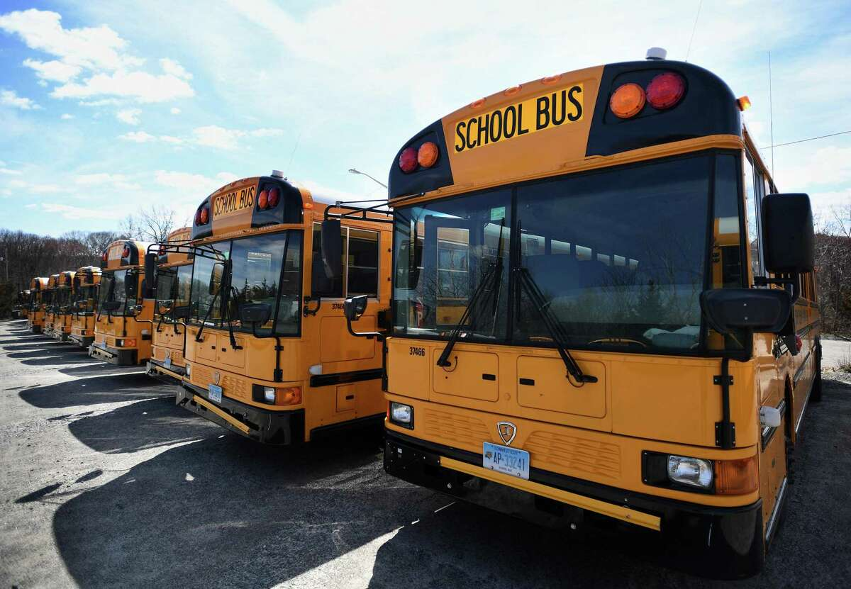 File photo of school buses parked at a bus depot, taken on April 1, 2020.