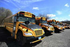 File photo of school buses parked in Trumbull, Conn., taken on Wednesday, April 1, 2020.