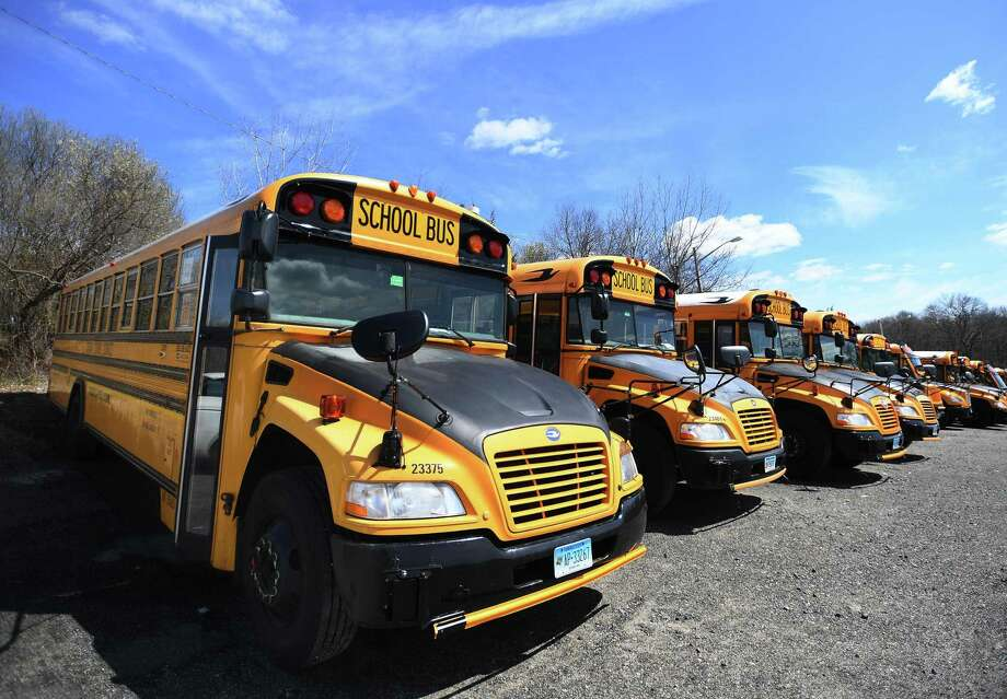 School buses are parked in neat rows at the Trumbull school bus depot at 81 Spring Hill Road in Trumbull, Conn. on Wednesday, April 1, 2020. Photo: Brian A. Pounds / Hearst Connecticut Media / Connecticut Post