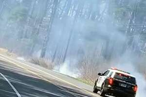 Shelton, Conn., firefighters extinguished a brush fire on Wednesday, April 1, 2020.
