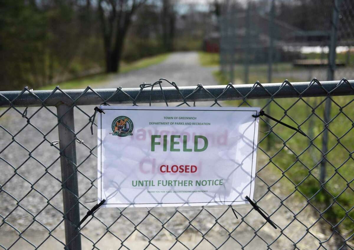 The closed sign is displayed at the playing fields at Greenwich High School in Greenwich, Conn. Wednesday, April 1, 2020.