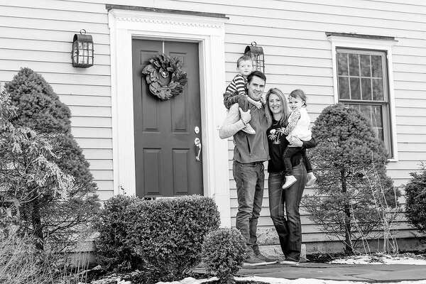 """Newtown photographer Kori Doss recently completed what she calls her """"PORCHtrait Project,"""" in which she captured family portraits of neighbors living through the COVID-19 pandemic."""