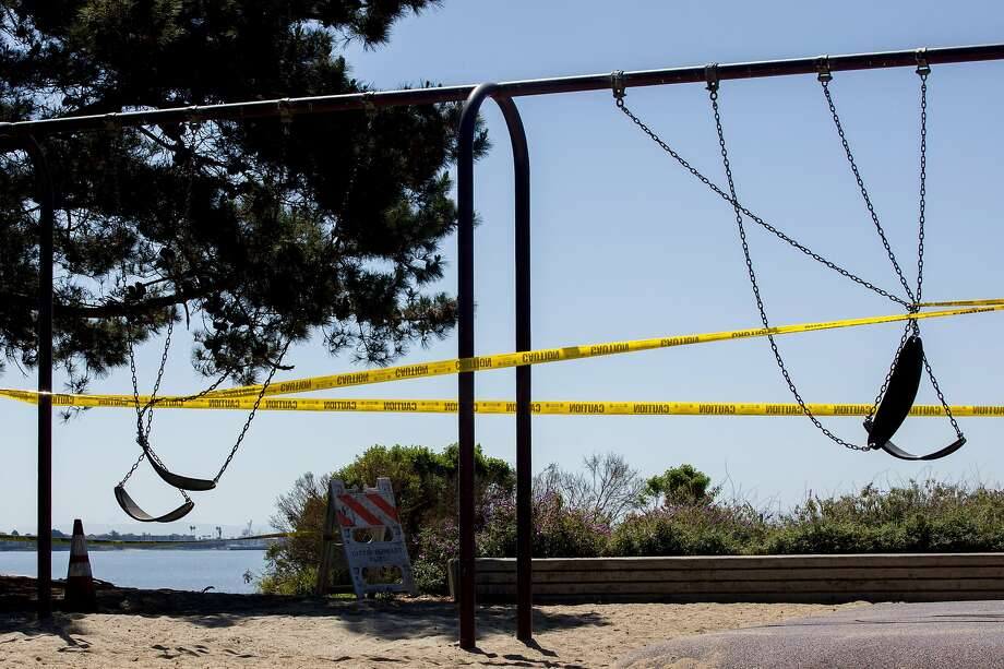 A swing at a playground at the Berkeley Marina is one of the many public park areas closed throughout Northern California in response to social distancing guidelines for the coronavirus pandemic. Photo: Jessica Christian / The Chronicle
