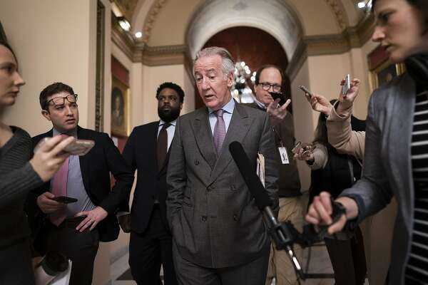 House Ways and Means Committee Chairman Richard Neal, D-Mass., is questioned by reporters as lawmakers work on a coronavirus aid package, at the Capitol in Washington, Friday, March 13, 2020. (AP Photo/J. Scott Applewhite)