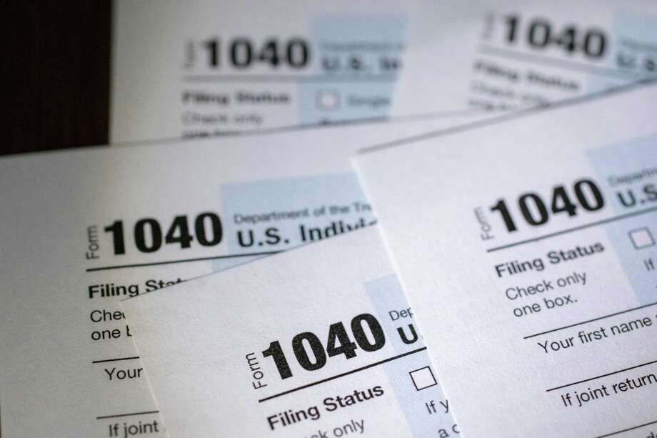U.S. Department of the Treasury Internal Revenue Service (IRS) 1040 Individual Income Tax forms for the 2019 tax year are arranged for a photograph in Tiskilwa, Illinois, U.S., on Friday, March 20, 2020. Tax forms and payments wont be due to the Internal Revenue Service until July 15 this year, Treasury Secretary Steven Mnuchin said in a tweet, as the government looks for ways to respond to the coronavirus. Photographer: Daniel Acker/Bloomberg Photo: Daniel Acker / Bloomberg / © 2020 Bloomberg Finance LP