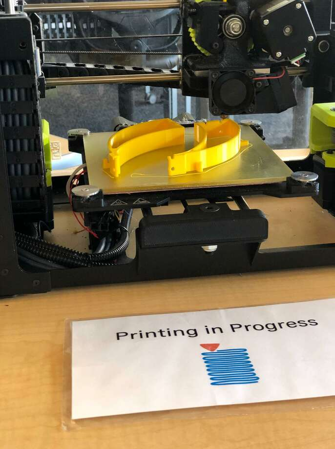 Parts for face shields to protect health care workers are being created on a 3D printer at the New Canaan Library. Photo: New Canaan Library / Contributed Photo