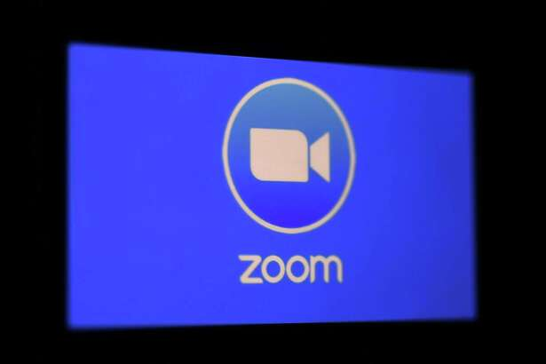 In this photo illustration a Zoom App logo is displayed on a smartphone on March 30, 2020 in Arlington, Virginia. - The Zoom video meeting and chat app has become the wildly popular host to millions of people working and studying from home during the coronavirus outbreak. (Photo by Olivier DOULIERY / AFP) (Photo by OLIVIER DOULIERY/AFP via Getty Images)