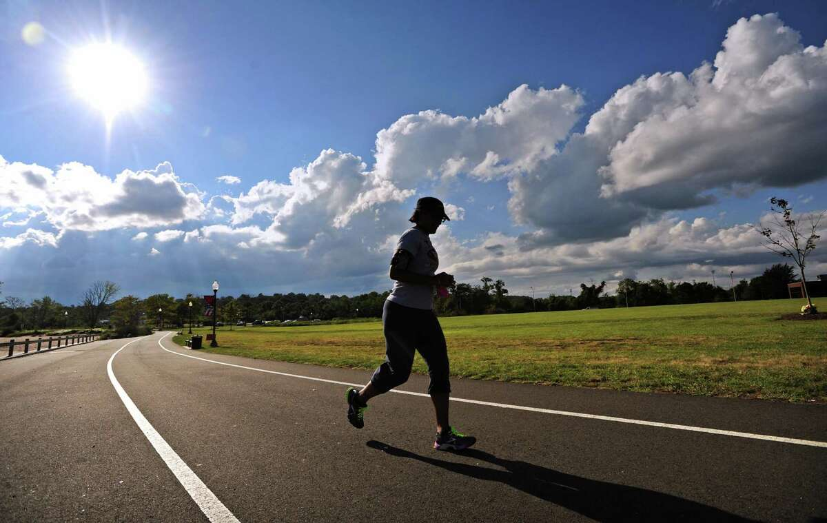 A woman enjoys a late afternoon run along the boardwalk in West Haven.