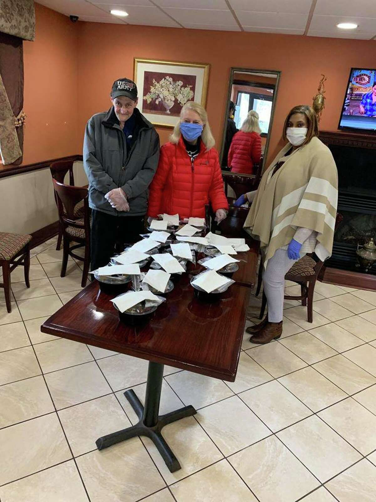FISH residents show a donation of protective masks at the shelter.