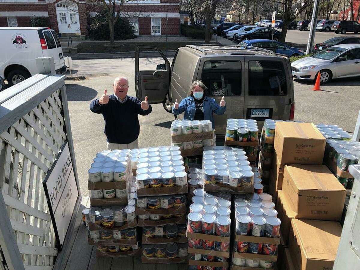 United Way of Northwest Connecticut executive director Owen Quinn and a volunteer deliver a load of food to FISH, Torrington's homeless shelter, earlier this year. Quinn is leading the Torrington Correct Count Committee, focused on getting as many people as possible to respond to the 2020 census.