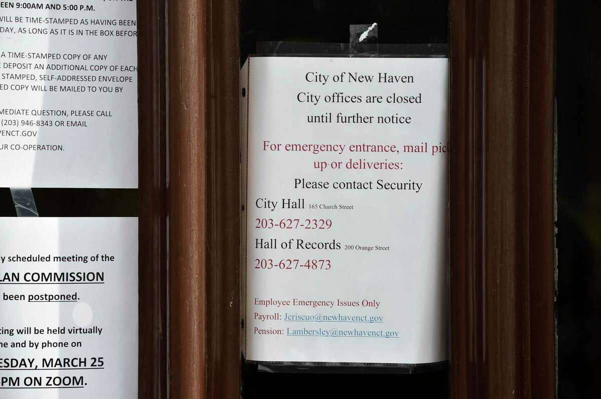 Closing notices on the front door of New Haven City Hall due to the cornavirus pandemic.