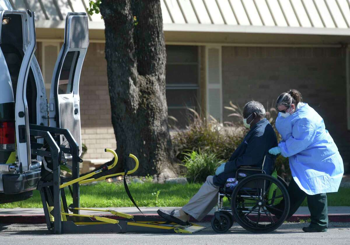 A resident is wheeled out of the Southeast Nursing and Rehabilitation Center, 4302 Southcross, on Wednesday, April 1, 2020. An outbreak is occurring at the facility, where six residents and six staff members have tested positive for the coronavirus. One person has died.