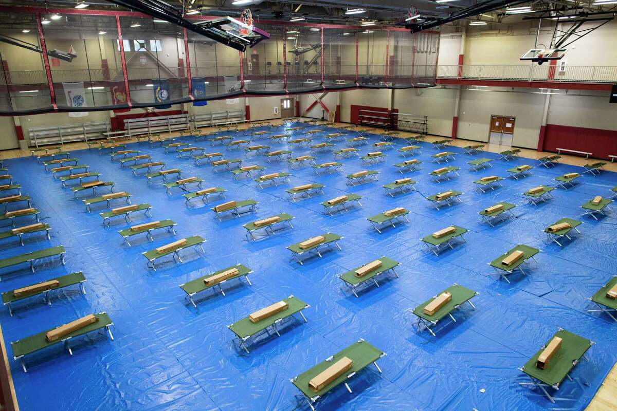 A gym at JBSA-Fort Sam Houston last week was equipped with cots to quarantine personnel awaiting coronavirus test results.