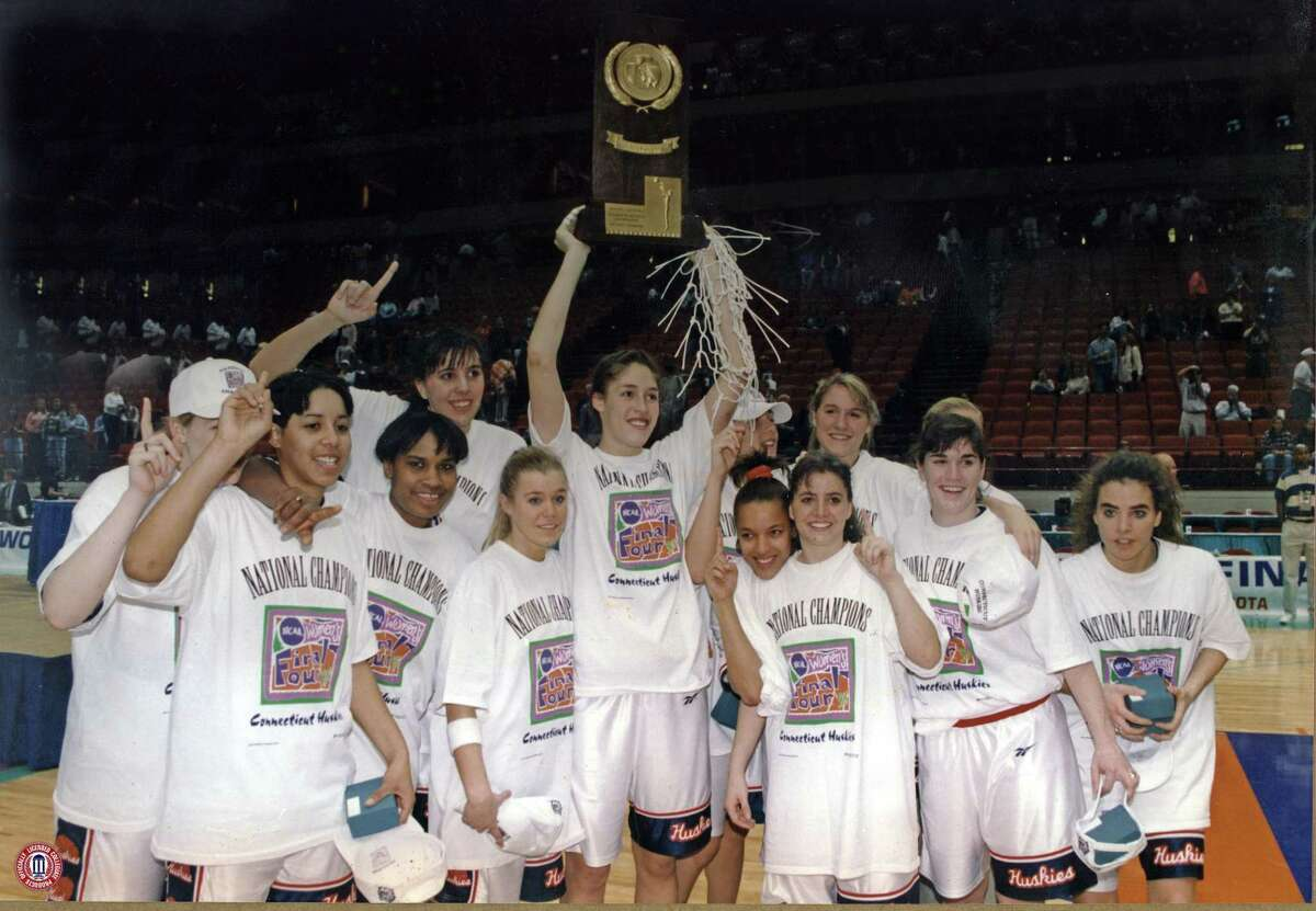 """UConn's Rebecca Lobo raises the trophy after after winning the NCAA championship game against Tennessee in April 1995. Lobo said her experience at UConn was much more low-key than today: """"It wasn't until my senior year at UConn that I felt my classmates on campus were really aware that I was a basketball player."""""""