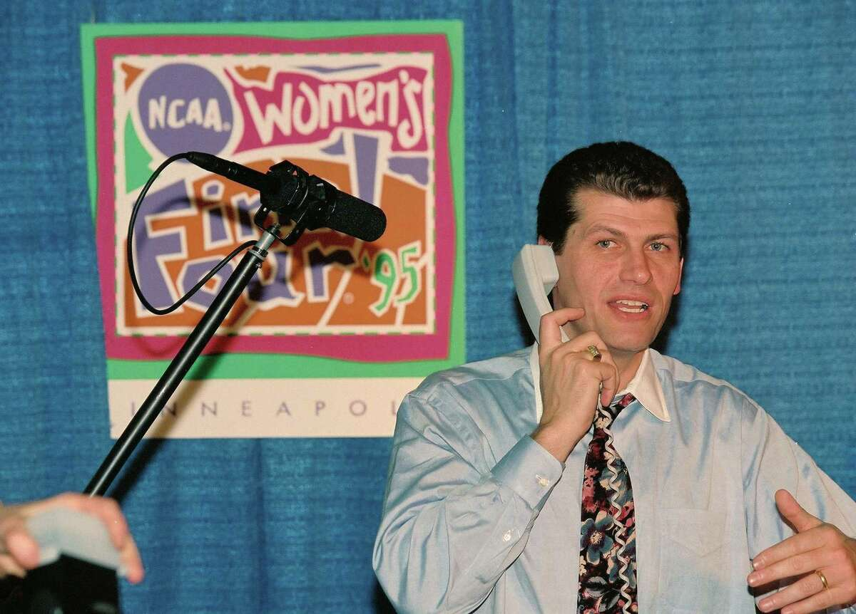 UConn coach Geno Auriemma accepts a call from President Bill Clinton following his team's victory in the national championship game in 1995.
