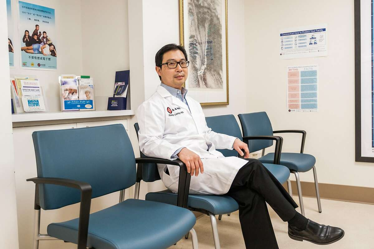 Dr. Man-Kit Leung, an ear, nose, and throat doctor poses for a photograph in the empty waiting room of his office in San Francisco, Calif. on Wednesday April 1, 2020.