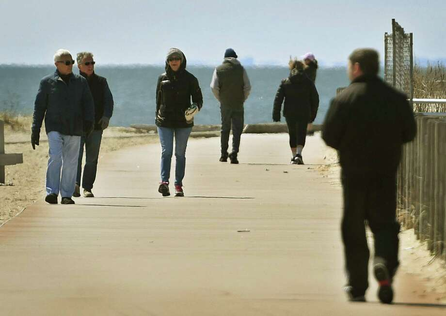 Visitors enjoy a sunny afternoon at Silver Sands State Park in Milford, Conn. on Wednesday, April 1, 2020. The Department of Energy and Environmental Protection announced plans to reduce capacity at popular parks to ensure social distancing in the wake of the coronavirus. Photo: Brian A. Pounds / Hearst Connecticut Media / Connecticut Post