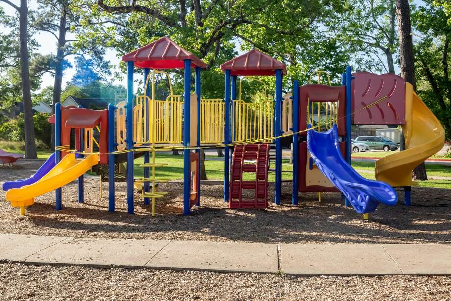 The City of Beaumont wrapped caution tape around all of the city's playground equipment on April 1, 2020 like this at Rogers Park to aid in slowing the spread of the coronavirus. Fran Ruchalski/The Enterprise Photo: Fran Ruchalski/The Enterprise / ? 2020 The Beaumont Enterprise