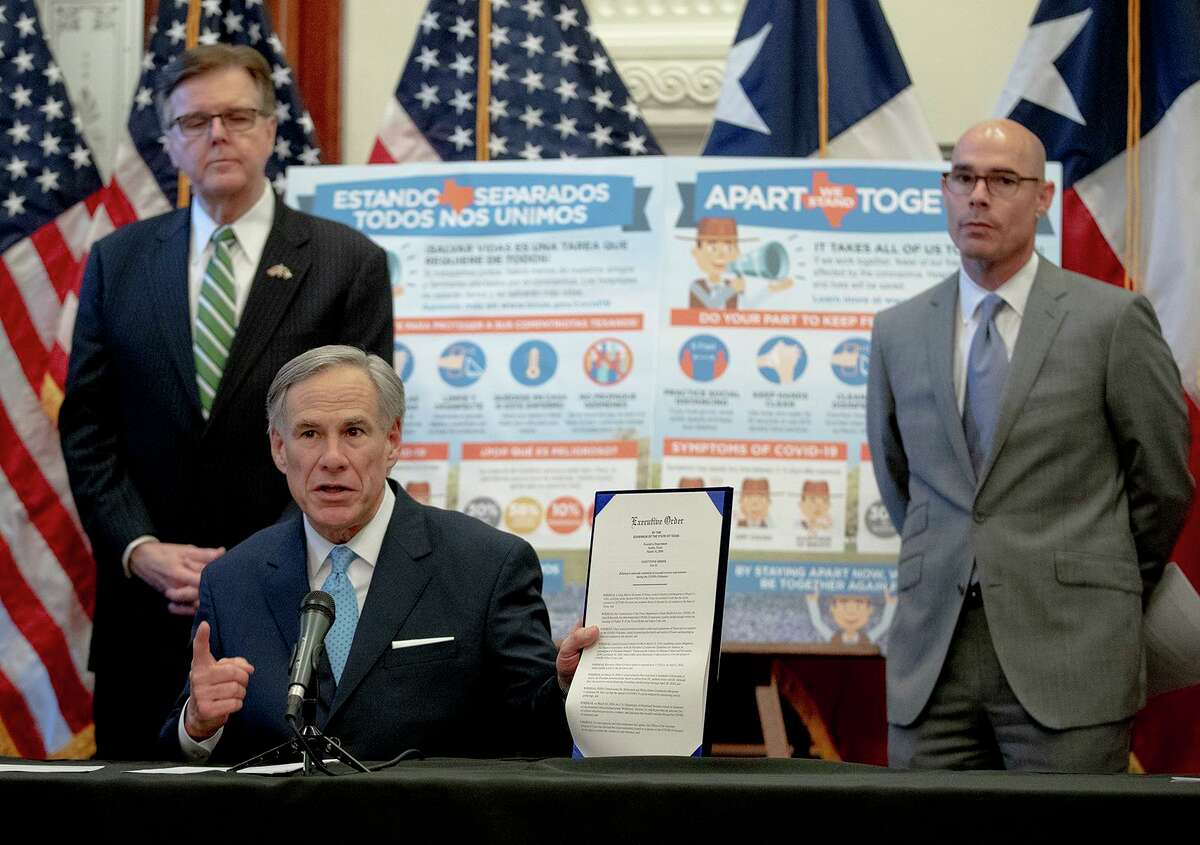 Texas Gov. Greg Abbott, flanked by Lt. Gov. Dan Patrick, left, and House Speaker Dennis Bonnen, speaks during a press conference at the state Capitol about the state's response to the coronavirus on Tuesday, March 31, 2020, in Austin, Texas. (Nick Wagner/Austin American-Statesman via AP)