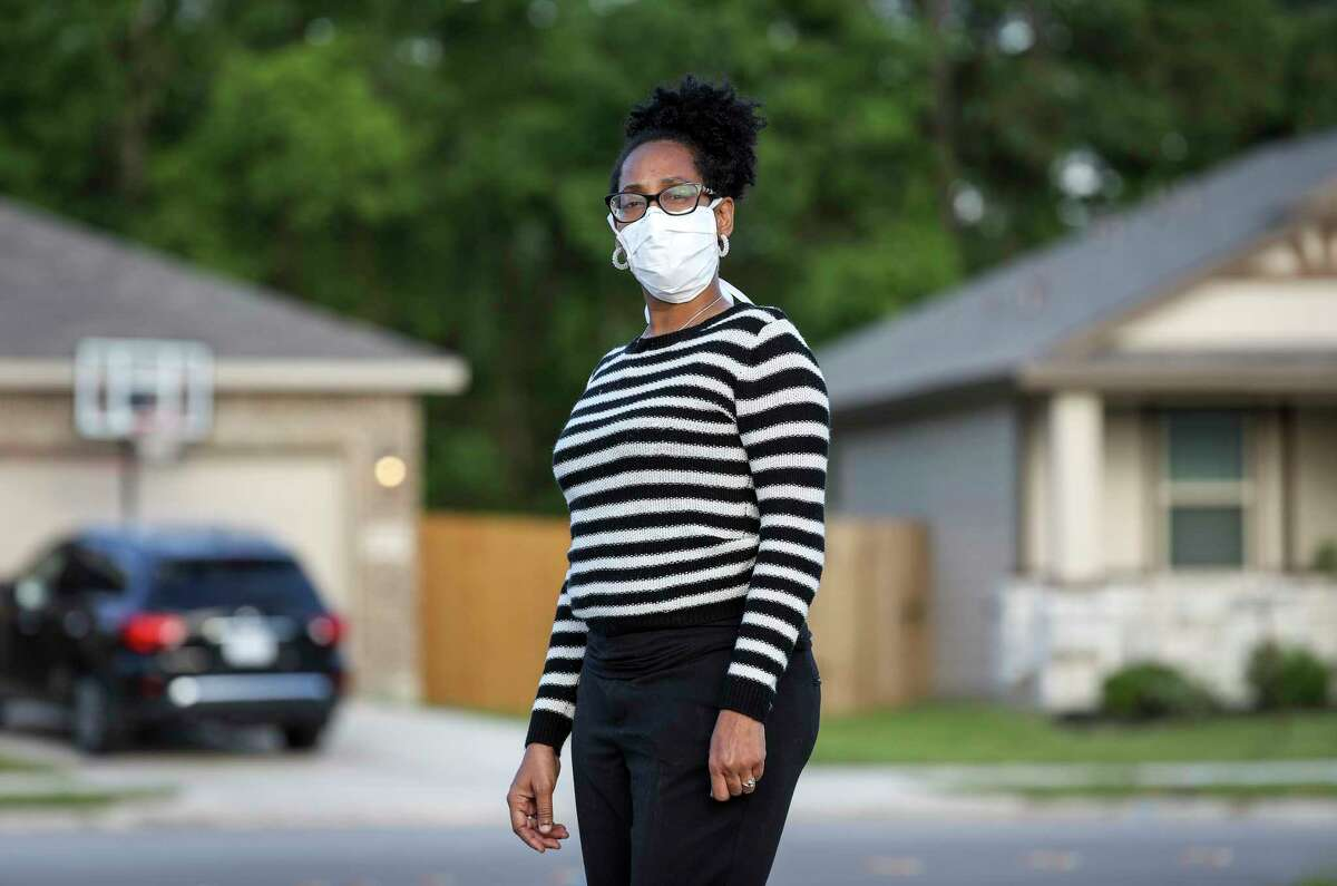 Tanya Mitchell, a nurse, poses for a portrait near her home Wednesday, April 1, 2020, in Houston. Her son, Markaylan Mitchell, is in the Harris County Jail, and she is advocating for his release, due to concerns about the spread of COVID-19.