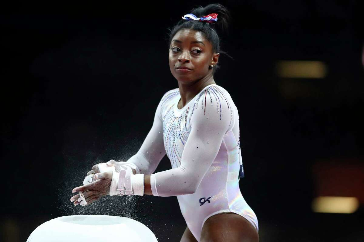 FILE - In this Oct. 10, 2019, file photo, Simone Biles of the United States gets ready to perform on the uneven bars in the women's all-around final at the Gymnastics World Championships in Stuttgart, Germany. Biles is pressing on to the 2021 Olympics. While she's confident her body will be fine next summer, she is concerned about the mental toll of another year of training. (AP Photo/Matthias Schrader, Fle)