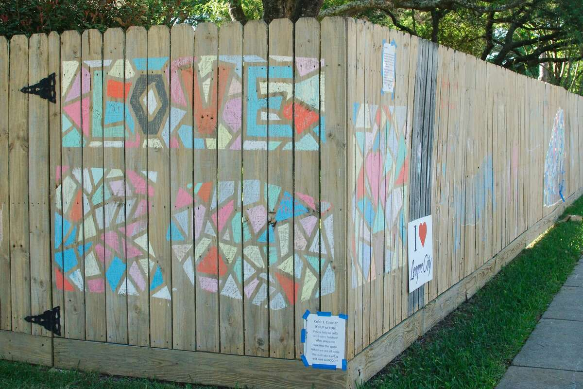 League City residents create fence graffiti art to pass the time during the mandatory stay at home order to prevent the spread of COVID-19.