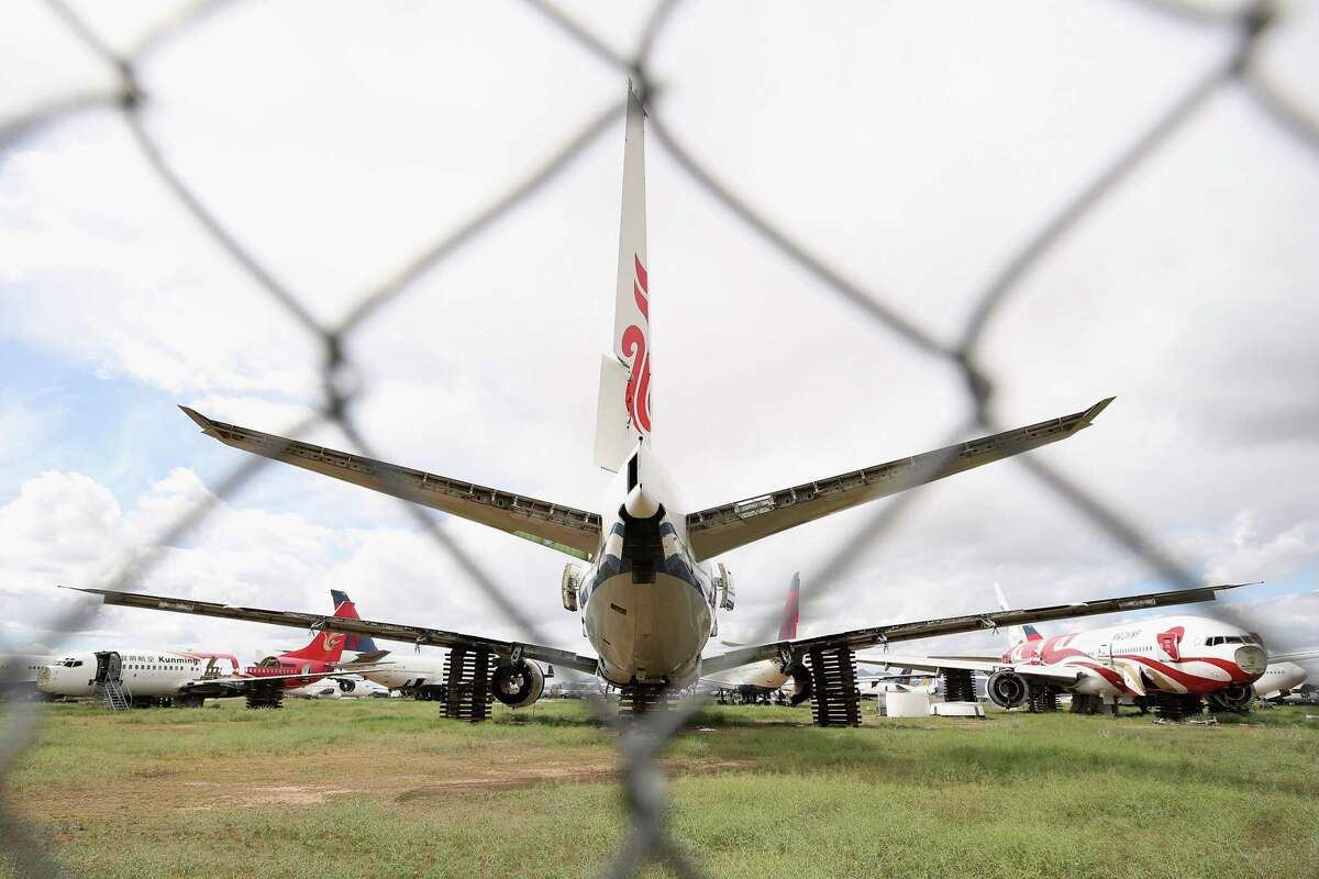 MARANA, ARIZONA - MARCH 19: Decommissioned and suspended commercial aircrafts are seen stored in Pinal Airpark on March 19, 2020 in Marana, Arizona. U.S. airlines are slashing their domestic and foreign flights in response to the coronavirus pandemic and President Donald Trump's travel ban and published reports say that some of the unused planes will end up at the facility. (Photo by Christian Petersen/Getty Images)