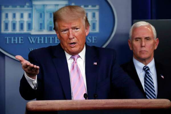 President Donald Trump speaks about the coronavirus in the James Brady Press Briefing Room of the White House, Wednesday, April 1, 2020, in Washington, as Vice President Mike Pence listens. (AP Photo/Alex Brandon)