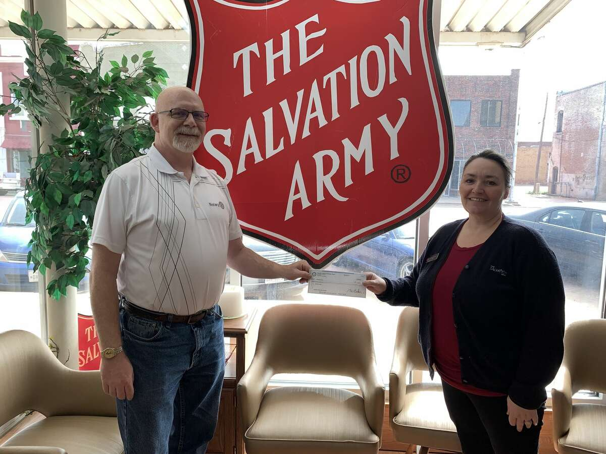 Salvation Army Director Michelle Rutherford with Givens.