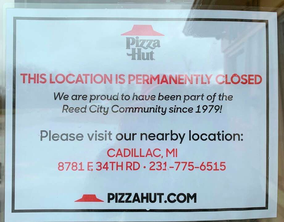 A sign on the door of the Pizza Hut in Reed City informs customers that the restaurant is closed permanently. The restaurant closed on March 29, due to lagging sales and increased expenses, according to a news release issued by the company. (Pioneer photo/Cathie Crew)