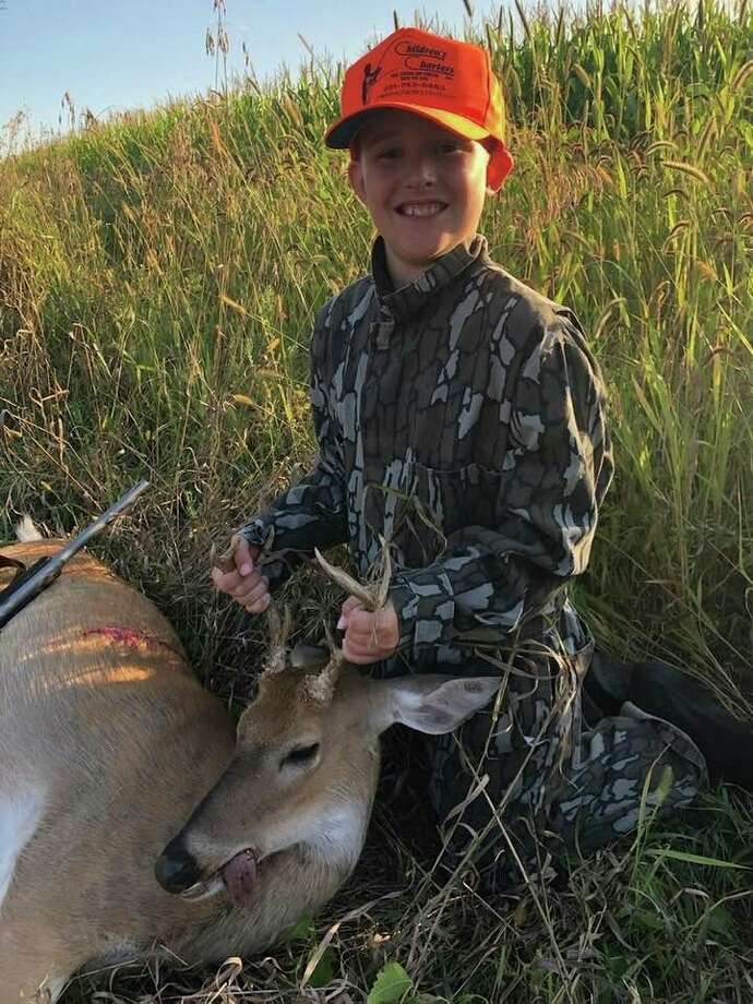 Thanks to plenty of practice with a Daisy BB gun, 10-year-old Orlando Lounsbury was able to automatically drop this Thumb seven-point buck on the spot with one shot during the 2019 Youth Deer Hunt, when it suddenly appeared out of the cover. He was being mentored by his father, Josh, and was using his grandpa Tom's T/C .44 Magnum Carbine. (Photo by Josh Lounsbury)