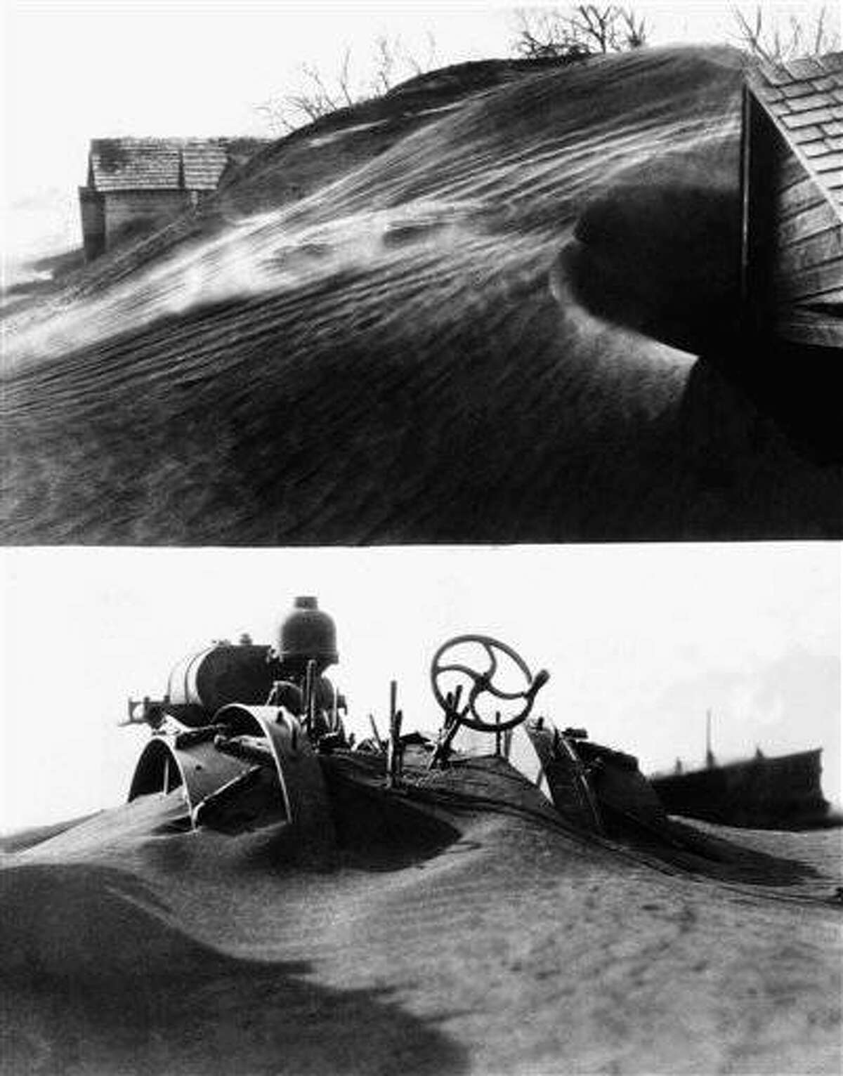 Piled high by drifting winds, dust laid a thick film over Tripp and Gregory counties covering everything in its path, April 2, 1935, Northeast South Dakota. These recent pictures show how farm implements and even buildings were nearly buried. (AP Photo)