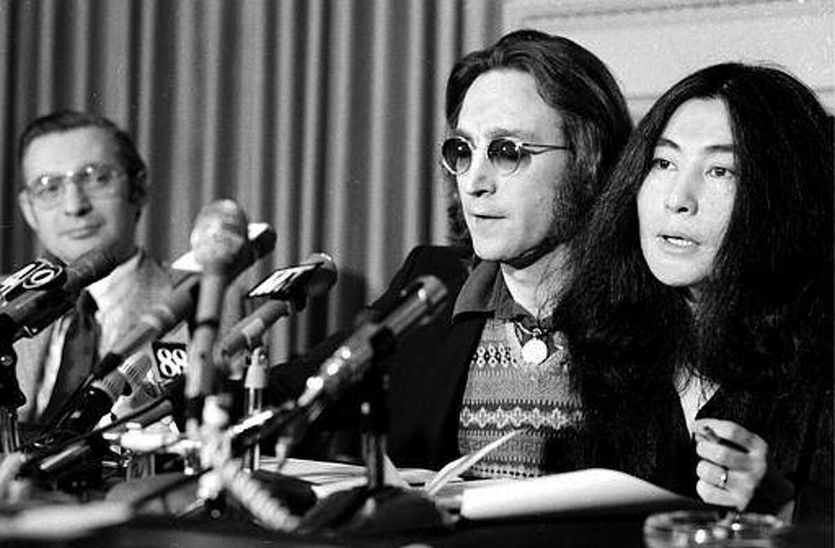 Former Beatle John Lennon and his wife, Yoko Ono, speak at a news conference in New York City, April 2, 1973. Lennon said he has appealed a federal deportation decision orderng him to leave the country in less than two months. His lawyer said the legal action could keep Lennon in the country for years. (AP Photo)