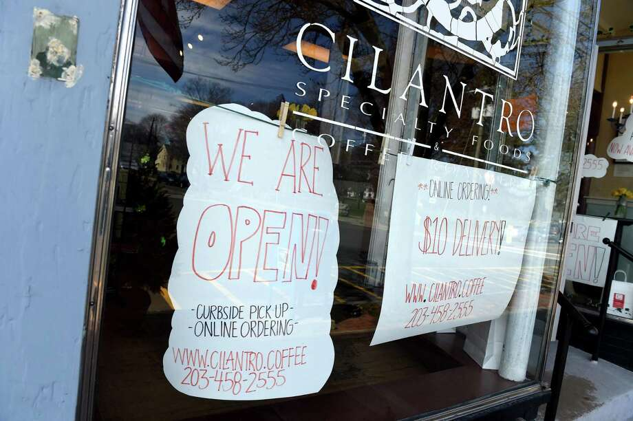 Cilantro Specialty Foods advertises online ordering on the front window of their Guilford food store and cafe on March 21, 2020. Photo: Arnold Gold / Hearst Connecticut Media / New Haven Register