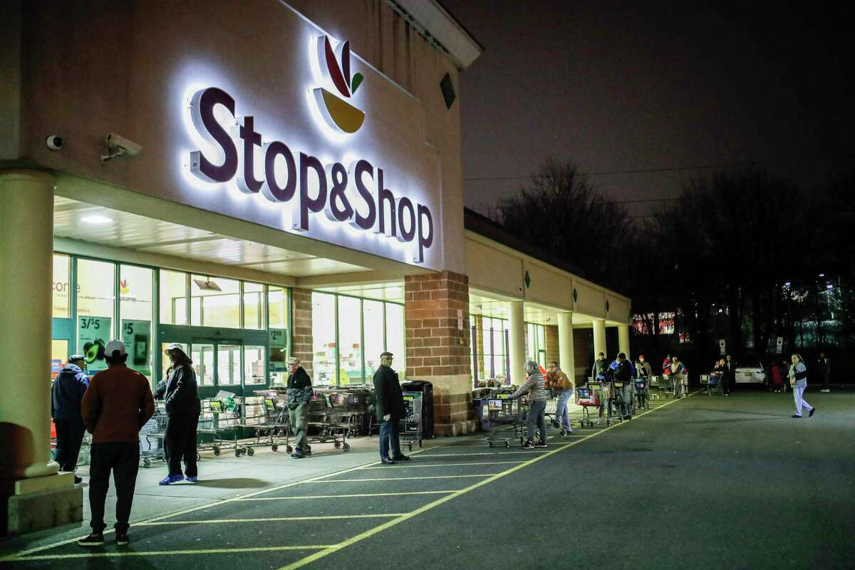 Customers practice social distancing in March 2020 at a Stop & Shop store in Teaneck, N.J.