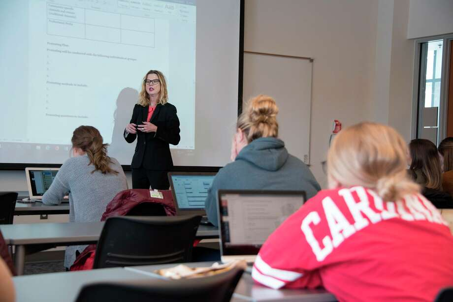In this photo from 2018, Chris Noller, assistant professor of health science, leads a class discussion at SVSU. (Photo provided/Tim Inman, SVSU)