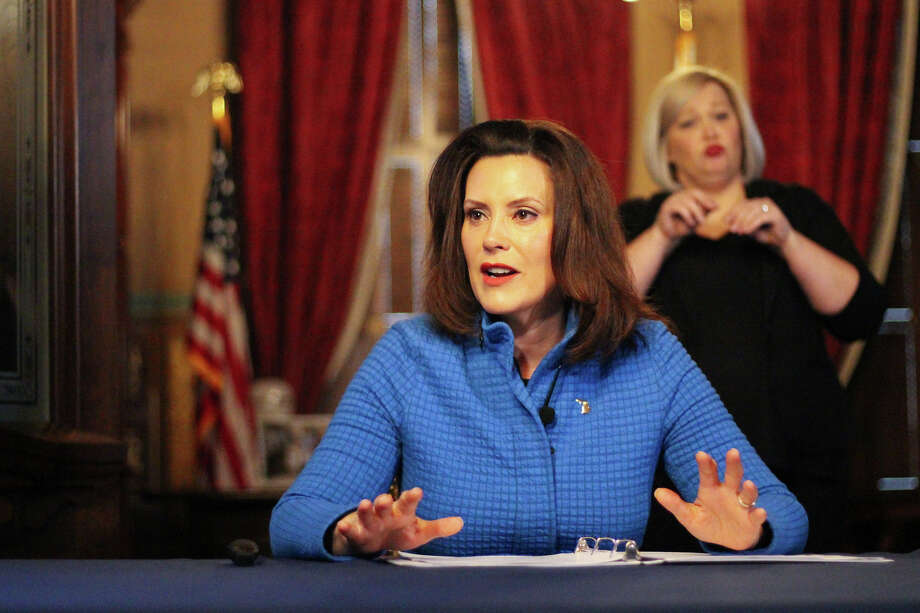 Gov. Gretchen Whitmer addresses the press during a press conference at the end of March. Photo: Michigan Executive Office Of The Governor/Courtesy Photo