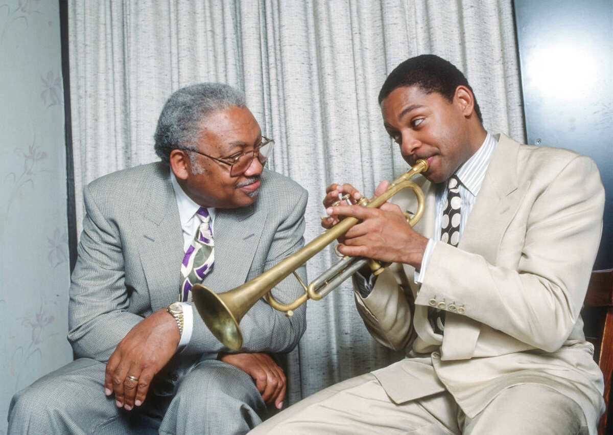 Jazz musician Ellis Marsalis Jr., left, shown with his son, fellow musician Wynton Marsalis, died April 1 from pneumonia brought on by the new coronavirus.  He was the teacher and patriarch of a New Orleans musical clan that included Wynton, a Pulitzer- and Grammy-winning trumpeter and artistic director of jazz at Lincoln Center.
