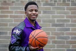 Morton Ranch High School basketball player LJ Cryer, photographed in his front yard in Katy, Monday, March 30, 2020.