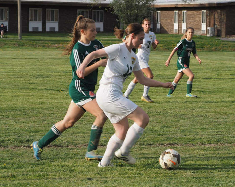 Metro-East Lutheran's Kathyrn Eberhart, right, battles for the ball during a game against Salem last season.