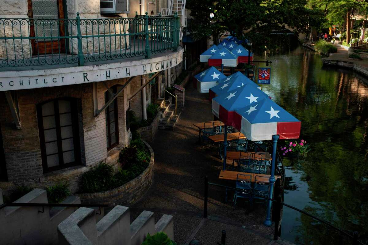 TOPSHOT - Restaurants are empty on the river walk on April 1, 2020 in downtown San Antonio, Texas, during a stay at home order amid the novel coronavirus outbreak. - The US death toll from the coronavirus pandemic topped 5,000 late on April 1, according to a running tally from Johns Hopkins University. (Photo by Mark Felix / AFP) (Photo by MARK FELIX/AFP /AFP via Getty Images)