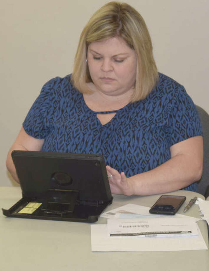 Lindsay McQueen, director of the Cass-Morgan Farm Bureau, does her online survey for the 2020 U.S. Census. McQueen is using an iPad provided by the Illinois Farm Bureau that her branch is using to provide people in Cass and Morgan Counties access to the survey.